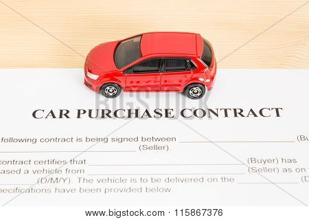 Car Purchase Contract With Red Car On Center