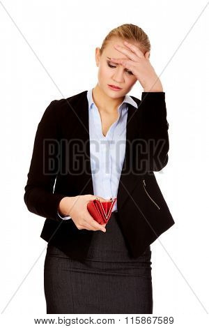 Shocked business woman looking into her empty wallet
