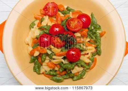 Colored Spatzle On Yellow Dish