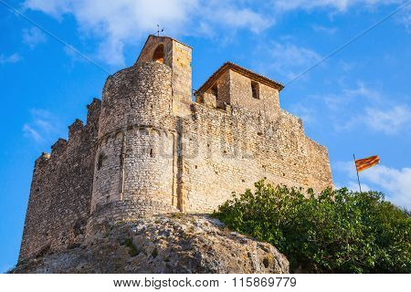 Medieval Stone Castle And Flag Of Catalonia, Spain