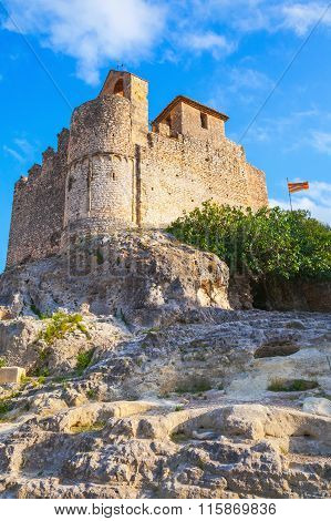 Medieval Stone Castle And Flag Of Catalonia
