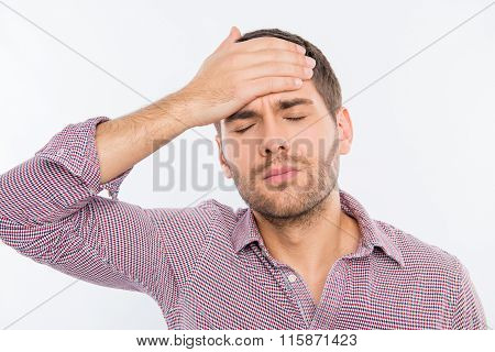 Handsome Young Man Touching His Head With One Hand Feeling Strong Headache