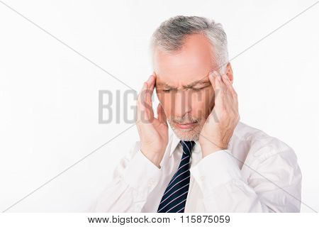 Old Businessman In Shirt And Tie Suffering From Migraine