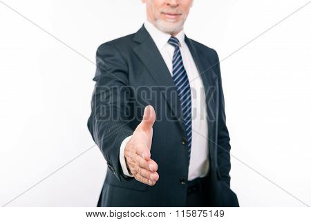 Close Up Portrait Of Old Businessman Reaching Out His Hand To Greet