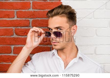 Smart Handsome Young Man Holding His Glasses
