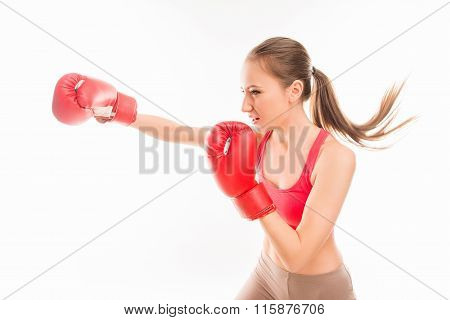 Beautiful Strong Sportswoman In Red Boxing Gloves Striking, Side View Photo