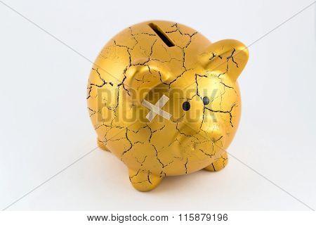 Concept Of Broken Gold Piggy Bank