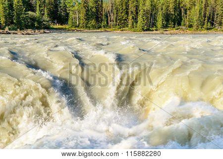 Gorgeous Waterfall at Athabaska River in Alberta, Canada.