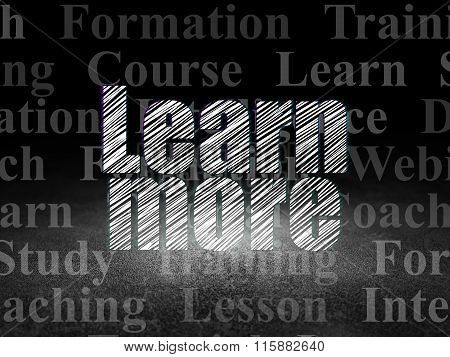 Education concept: Learn More in grunge dark room