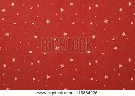 Close-up of red felt with stars background.