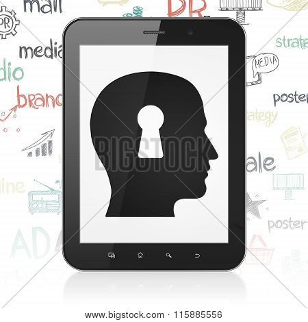 Advertising concept: Tablet Computer with Head With Keyhole on display