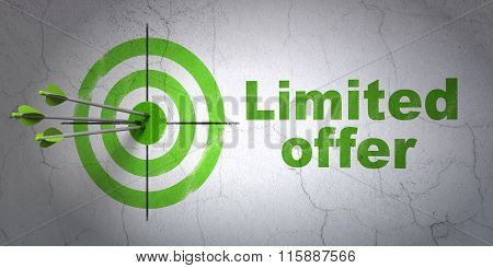 Finance concept: target and Limited Offer on wall background