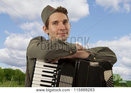 Portrait Of Soviet Soldier With Accordion