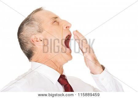 Sleepy businessman yawning