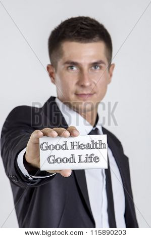 Good Health - Good Life - Young Businessman Holding A White Card With Text