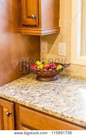 Apple Bowl On Granite Countertop