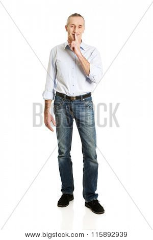 Man with silent gesture