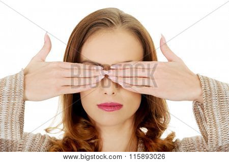 Beautiful woman covering eyes.