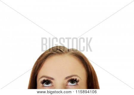 Female eyes looking up.