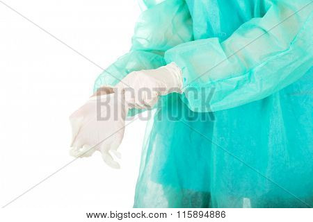 Doctor putting sterilized medical glove.