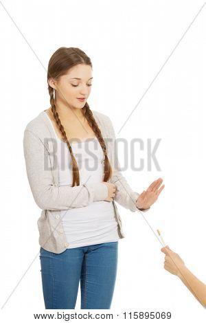 Young woman refuses to smoke.
