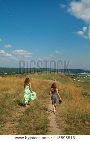 Two Girls Walking Down The Hill