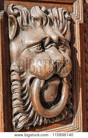 Lion head wood carving on wooden door