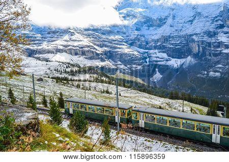Mountain Train Crossing The Snowy Swiss Alps