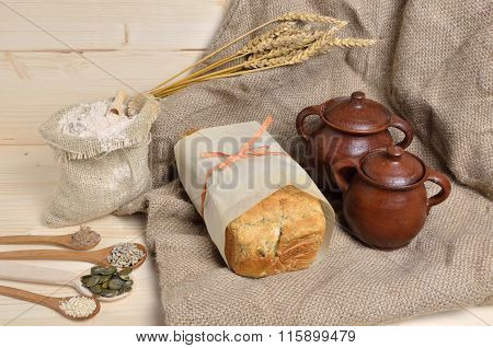 Handmade Bread, Seeds And Pots
