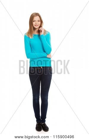 Young woman standing with toothy smile
