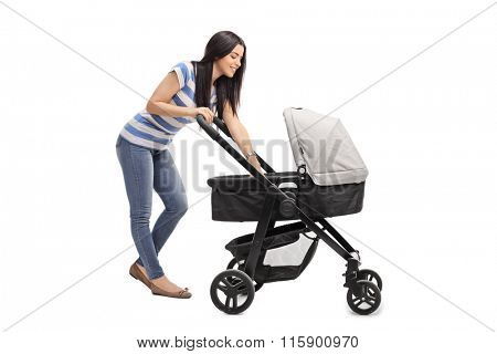 Young mother playing with her baby in a baby stroller isolated on white background