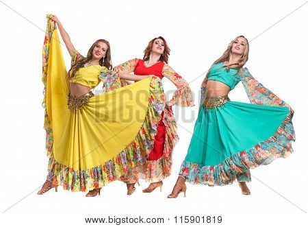 three female dancers posing, isolated on white in full length