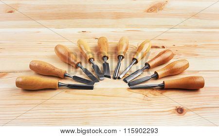 Set of Chisels on wooden background