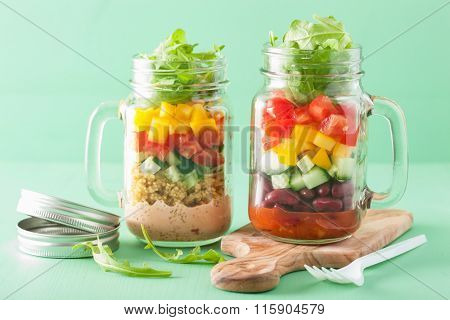 vegan quinoa bean vegetable salad in mason jars