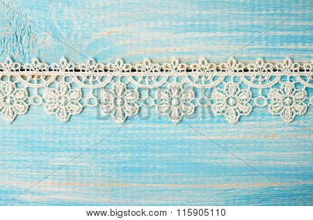 Embroidery ribbon on wooden surface