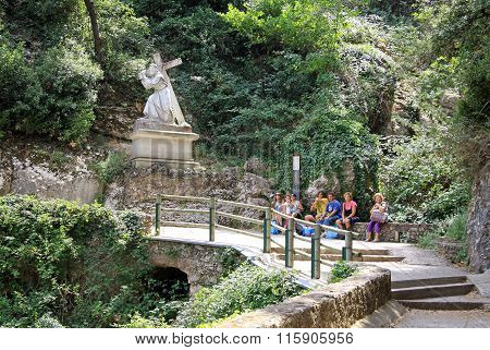 Montserrat, Spain - August 28, 2012: Statue The Road To Calvary Carrying The Cross At The Benedictin