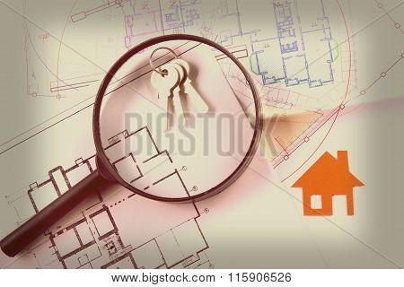 Model house, construction plan for house building, keys. Real Estate Concept.