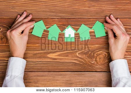 Real Estate Concept.  Paper house figure and blank business card