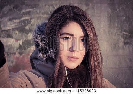 Portrait Of A Teenage Girl Outdoor Wearing Winter Coat