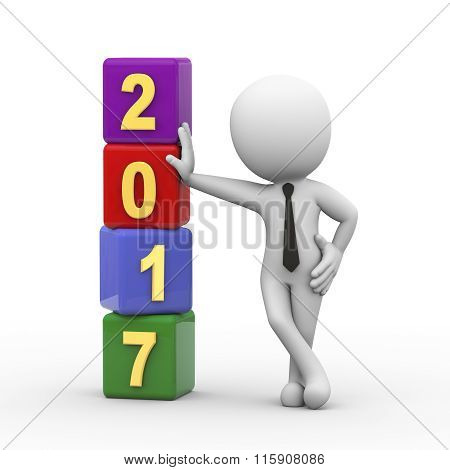 3D Businessman With New Year 2017 Cubes