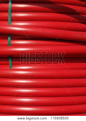 Closeup Of Coils Of Large Red Hoses