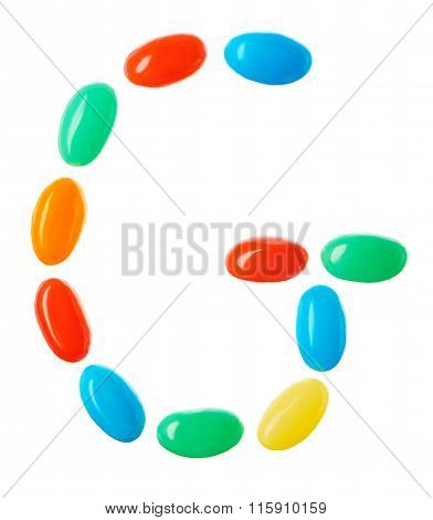 G Letter Made Of Multicolored Candies Isolated On White