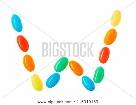 W Letter Made Of Multicolored Candies Isolated On White
