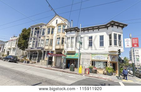 Steep Street With Old Buildings Typical For San Francisco.