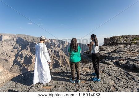 Tourists With An Omani Guide At Grand Canyon, Oman