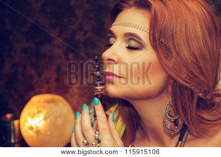 Young Beautiful Woman Enjoying Aroma Of Perfume.