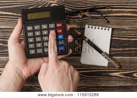 Business concept with pen, notebook and calculator