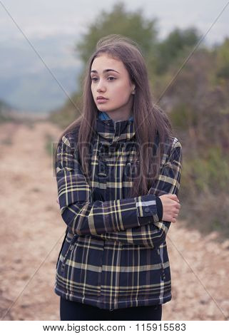 Portrait of young brunette hiking outdoors in nature.