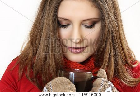 The Young Woman In Red Clothes And Mittens Holds A Cup Of Fragrant Tea In Hand