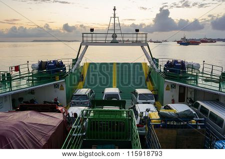 Ferry with vehicles on board in the morning,carries passengers and vehicle